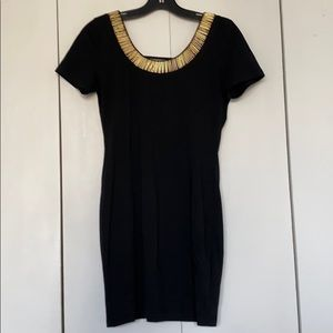 Black mini dress with gold bead detail